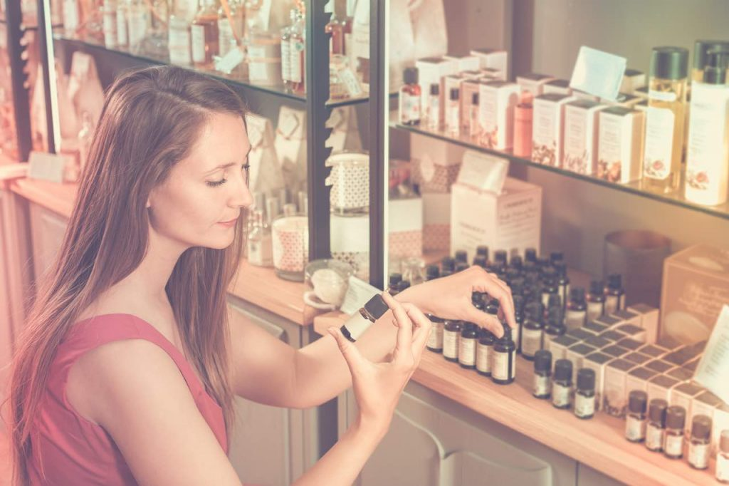 Young woman choosing essential oil